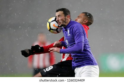 BUDAPEST, HUNGARY - DECEMBER 15, 2018: (r-l) David N'Gog of Honved #89 battles for the ball in the air with Kire Ristevski of Ujpest FC during Budapest Honved v Ujpest FC match at Hidegkuti Stadium.