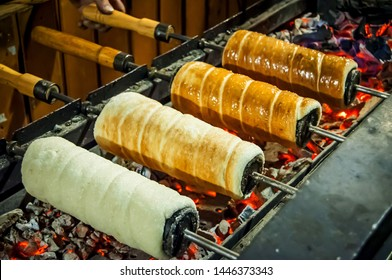 BUDAPEST, HUNGARY. December 16, 2017. Traditional Hungarian trozkol spit cake (Kürtőskalács in Hungarian) grilled in the streets of Budapest.