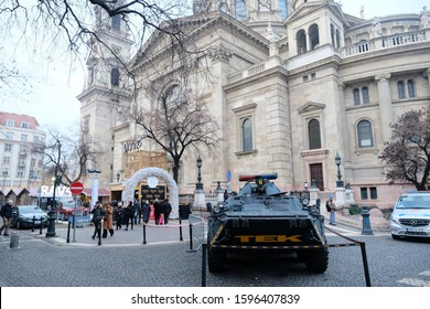 Budapest, Hungary. December 16, 2019: Hungarian police water cannon or military tank at square near St.Stephen's Basilica in Budapest. Budapest Christmas Fair and Winter Festival, Christmas market.