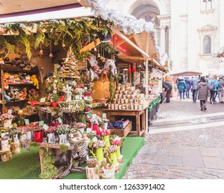 BUDAPEST, HUNGARY - DECEMBER 19, 2018: Tourists and local people enjoying the beautiful Christmas Market at St. Stephen's Square in front of the St. Stephen's Basilica.