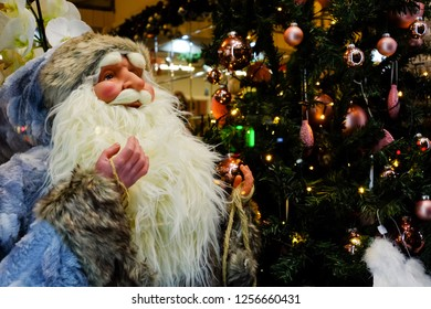 BUDAPEST, HUNGARY - DECEMBER 20, 2017: Toy Saint Nicholas for sale in the store on the background of Christmas tree and lights lamps.