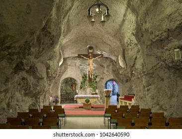 BUDAPEST, HUNGARY - DECEMBER 6, 2016: Main chapel of Cave Church in Gellert Hill Cave (also referred to as Saint Ivan's Cave). The church is the part of the rock monastery belonged to Pauline order.