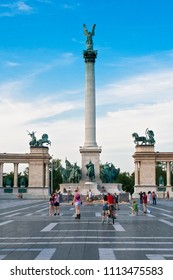 Budapest, Hungary, Europe. June, 22, 2016. Hosok Tere or Millennium Monument, major attraction of city, with 36 m high Corinthian column in center.  Tourists visit Millennium Monument in Heroes Square