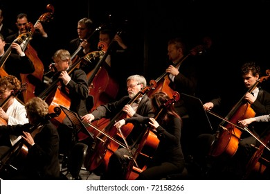 BUDAPEST, HUNGARY - FEB 26: Members of the Szegedi Symphonic Orchestra performs at The Thalia Theatre stage on February 26, 2011 in Budapest, Hungary.