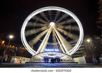 BUDAPEST, HUNGARY - FEBRUARY 02,2018: Budapest Eye in slow motion during night at Elisabeth square in Budapest, Hungary.
