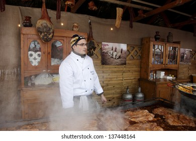 BUDAPEST, HUNGARY - FEBRUARY 07: unidentified man cooks at the Mangalica Festival on February 07, 2010 in Budapest, Hungary