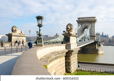 Budapest, Hungary - February 20, 2016: The Szechenyi Chain Bridge is a suspension bridge that spans the River Danube between Buda and Pest. The Guardian lions at each of the abutments carved in stone.