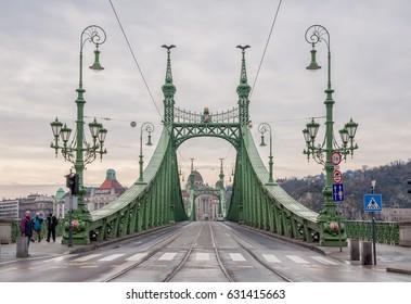 BUDAPEST, HUNGARY - FEBRUARY 21, 2016: Liberty Bridge or Freedom Bridge in Budapest, Hungary, connects Buda and Pest across the River Danube.