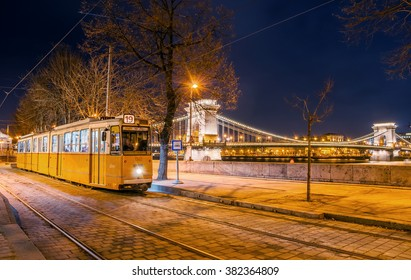 BUDAPEST, HUNGARY - FEBRUARY 22, 2016: Night view of the tram on the background of the Chain Bridge in Budapest, Hungary.