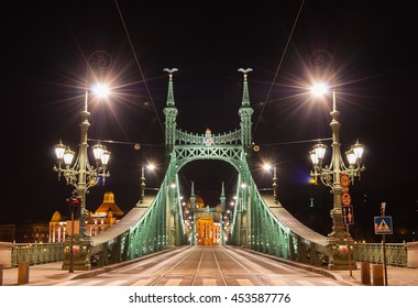 BUDAPEST, HUNGARY - FEBRUARY 22, 2016: Night view of Liberty Bridge (Freedom Bridge) in Budapest, Hungary, connects Buda and Pest across the River Danube.