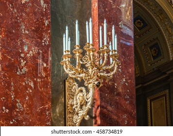 BUDAPEST, HUNGARY - FEBRUARY 22, 2016: Candlestick in the Roman Catholic Church of St. Stephen's Basilica in Budapest, Hungary. Details of the interior of the cathedral.