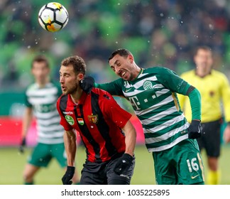 BUDAPEST, HUNGARY - FEBRUARY 24, 2018: Leandro De Almeida 'Leo' #16 of FTC fights for the ball with Marton Eppel (L) of Budapest Honved during Ferencvarosi TC v Budapest Honved match at Groupama Arena