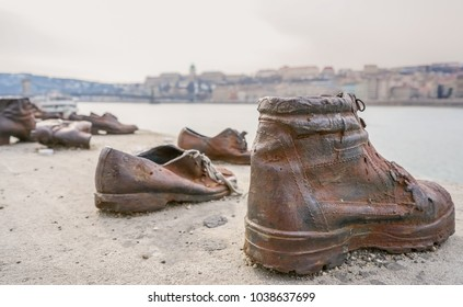 """BUDAPEST, HUNGARY - February 26, 2018., """"Bank of the Danube - Monument of Shoes""""as a memorial of victims of the Holocaust who were ordered to stand near the river and were then shot to death"""
