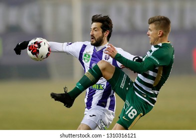BUDAPEST, HUNGARY - FEBRUARY 9, 2019: (r-l) David Siger fights for the ball with Daniel Nagy during the Ujpest FC and Ferencvarosi TC match at Ferenc Szusza Stadium.