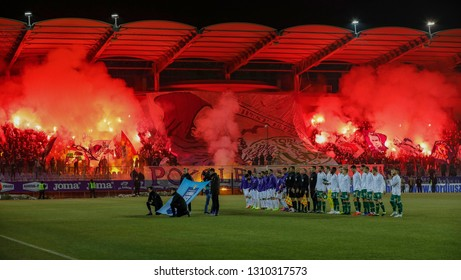 BUDAPEST, HUNGARY - FEBRUARY 9, 2019: Ultra fans light torches prior to the Ujpest FC and Ferencvarosi TC match at Ferenc Szusza Stadium.