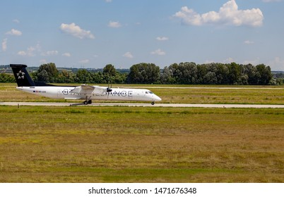 Budapest Hungary International Airport Aug 5 2019: Staralliance Airline Des 8 OE-LGQ just taking off from Budapest International airport.