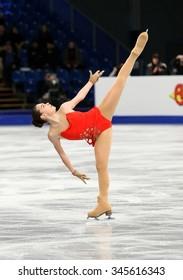 BUDAPEST, HUNGARY - JANUARY 15, 2014: Adelina SOTNIKOVA of Russia performs short program at ISU European Figure Skating Championship in Syma Hall Arena.
