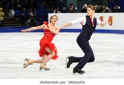 BUDAPEST, HUNGARY - JANUARY 15, 2014: Pernelle CARRON / Lloyd JONES of France perform short dance at ISU European Figure Skating Championship in Syma Hall Arena.