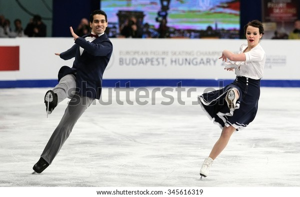 BUDAPEST, HUNGARY - JANUARY 15, 2014: Anna CAPPELLINI / Luca LANOTTE of Italy perform short dance at ISU European Figure Skating Championship in Syma Hall Arena.
