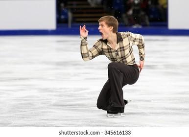 BUDAPEST, HUNGARY - JANUARY 16, 2014: Tomas VERNER of Czech Republic performs short program at ISU European Figure Skating Championship in Syma Hall Arena.