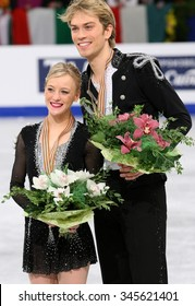 BUDAPEST, HUNGARY - JANUARY 16, 2014: Penny COOMES / Nicholas BUCKLAND pose at the victory ceremony at ISU European Figure Skating Championship in Syma Hall Arena.