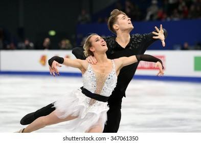BUDAPEST, HUNGARY - JANUARY 16, 2014: Pernelle CARRON / Lloyd JONES of France perform free dance at ISU European Figure Skating Championship in Syma Hall Arena.