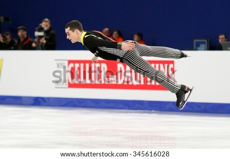 BUDAPEST, HUNGARY - JANUARY 16, 2014: Javier FERNANDEZ of Spain performs short program at ISU European Figure Skating Championship in Syma Hall Arena.