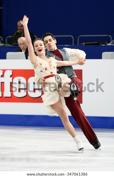 BUDAPEST, HUNGARY - JANUARY 16, 2014: Anna CAPPELLINI / Luca LANOTTE of Italy perform free dance at ISU European Figure Skating Championship in Syma Hall Arena.