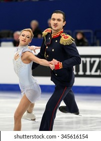 BUDAPEST, HUNGARY - JANUARY 17, 2014: Tatiana VOLOSOZHAR / Maxim TRANKOV of Russia perform short program at ISU European Figure Skating Championship in Syma Hall Arena.