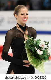 BUDAPEST, HUNGARY - JANUARY 17, 2014: Carolina KOSTNER of Italy poses at the victory ceremony at ISU European Figure Skating Championship in Syma Hall Arena.