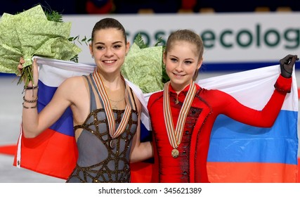 BUDAPEST, HUNGARY - JANUARY 17, 2014: Adelina SOTNIKOVA and Julia LIPNITSKAIA pose at the victory ceremony at ISU European Figure Skating Championship in Syma Hall Arena.