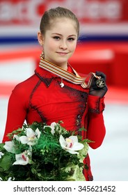 BUDAPEST, HUNGARY - JANUARY 17, 2014: Julia LIPNITSKAIA of Russia poses at the victory ceremony at ISU European Figure Skating Championship in Syma Hall Arena.