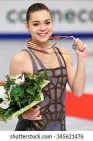 BUDAPEST, HUNGARY - JANUARY 17, 2014: Adelina SOTNIKOVA of Russia poses at the victory ceremony at ISU European Figure Skating Championship in Syma Hall Arena.