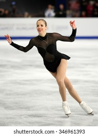 BUDAPEST, HUNGARY - JANUARY 17, 2014: Carolina KOSTNER of Italy performs free program at ISU European Figure Skating Championship in Syma Hall Arena.