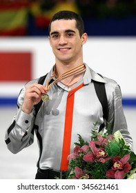 BUDAPEST, HUNGARY - JANUARY 18, 2014: Javier FERNANDEZ of Spain poses at the victory ceremony at ISU European Figure Skating Championship in Syma Hall Arena.