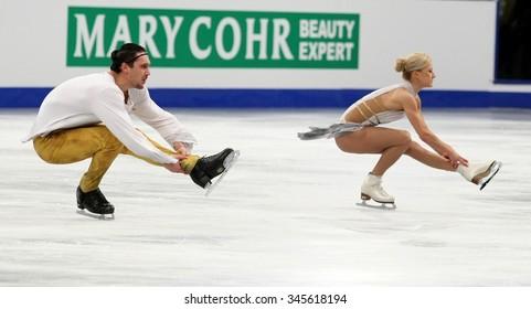 BUDAPEST, HUNGARY - JANUARY 19, 2014: Tatiana VOLOSOZHAR / Maxim TRANKOV of Russia perform free program at ISU European Figure Skating Championship in Syma Hall Arena.