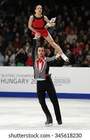 BUDAPEST, HUNGARY - JANUARY 19, 2014: Ksenia STOLBOVA / Fedor KLIMOV of Russia perform free program at ISU European Figure Skating Championship in Syma Hall Arena.