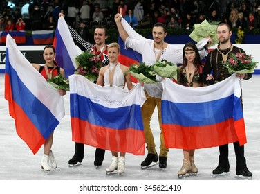 BUDAPEST, HUNGARY - JANUARY 19, 2014: STOLBOVA/KLIMOV, VOLOSOZHAR/TRANKOV, BAZAROVA/LARIONOV pose at the victory ceremony at ISU European Figure Skating Championship in Syma Hall Arena.