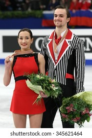 BUDAPEST, HUNGARY - JANUARY 19, 2014: Ksenia STOLBOVA / Fedor KLIMOV of Russia pose at the victory ceremony at ISU European Figure Skating Championship in Syma Hall Arena.