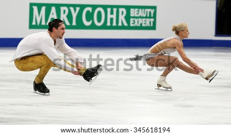 BUDAPEST, HUNGARY - JANUARY 19, 2014: Tatiana VOLOSOZHAR / Maxim TRANKOV of Russia perform free program at ISU European Figure Skating Championship in Syma Hall Arena.