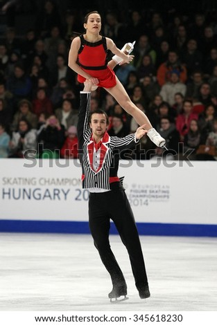 BUDAPEST, HUNGARY - JANUARY 19, 2014: Ksenia STOLBOVA / Fedor KLIMOV of Russia perform free program at ISU European Figure Skating Championship in Syma Hall Arena.