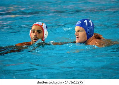 Budapest, Hungary - Jul 14, 2014. MINGUELL ALFEREZ Marc (ESP, 6) and TOTH Marton (HUN, 11) waiting for the ball.The Waterpolo European Championship was held in Alfred Hajos Swimming Centre in 2014.