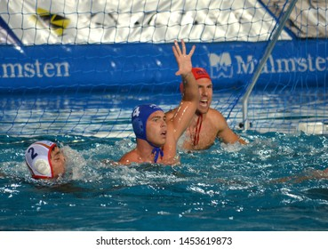 Budapest, Hungary - Jul 14, 2014. ERDELYI Balazs (HUN, 4) and NAGY Viktor (HUN, 1) goalkeeper are defending. The Waterpolo European Championship was held in Alfred Hajos Swimming Centre in 2014.