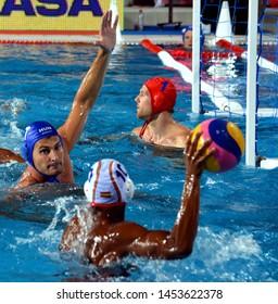Budapest, Hungary - Jul 14, 2014. Adam Decker (HUN, 7) defending against FERNANDEZ MIRANDA Francisco (ESP, 10).The Waterpolo European Championship was held in Alfred Hajos Swimming Centre in 2014.