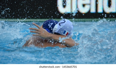 Budapest, Hungary - Jul 14, 2014. Alexandre CAMARASA (FRA, 12) and Sava RANDJELOVIC (SRB, 4) wrestling in the pool. Waterpolo European Championship was held in Alfred Hajos Swimming Centre in 2014.
