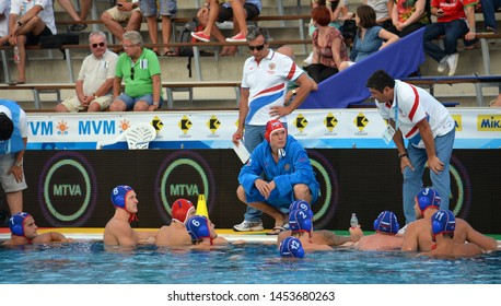 Budapest, Hungary - Jul 14, 2014. SOBCHENKO Viacheslav head coach and the russian men waterpolo team in the break. LEN Waterpolo European Championship was held in Alfred Hajos Swimming Centre in 2014.