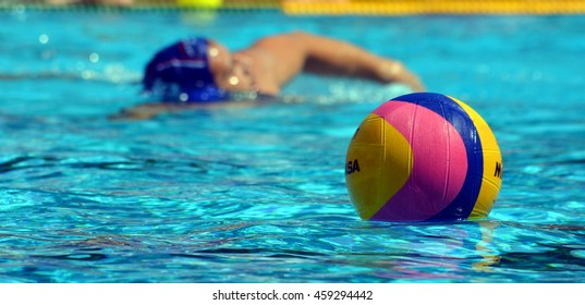 Budapest, Hungary - Jul 14, 2014. Waterpolo ball and player. The Waterpolo European Championship was held in Alfred Hajos Swimming Centre in 2014.