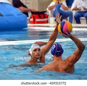 Budapest, Hungary - Jul 14, 2014. Francesco DI FULVIO (ITA, 2) defends against Roman SHEPELEV (RUS, 12).The Waterpolo European Championship was held in Alfred Hajos Swimming Centre in 2014.