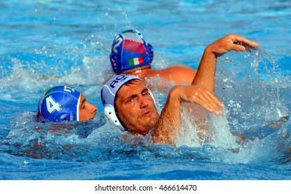 Budapest, Hungary - Jul 15, 2014. Waterpolo ballet a' la Pietro FIGLIOLI (ITA, 4) and Cosmin RADU (ROM, 2).   The Waterpolo European Championship was held in Alfred Hajos Swimming Centre in 2014.