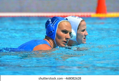 Budapest, Hungary - Jul 16, 2014. TSOUKALA Christina (GRE 2) defending against  WINSTANLEY-SMITH Angela (GBR 10). The Waterpolo European Championship was held in Alfred Hajos Swimming Centre in 2014.